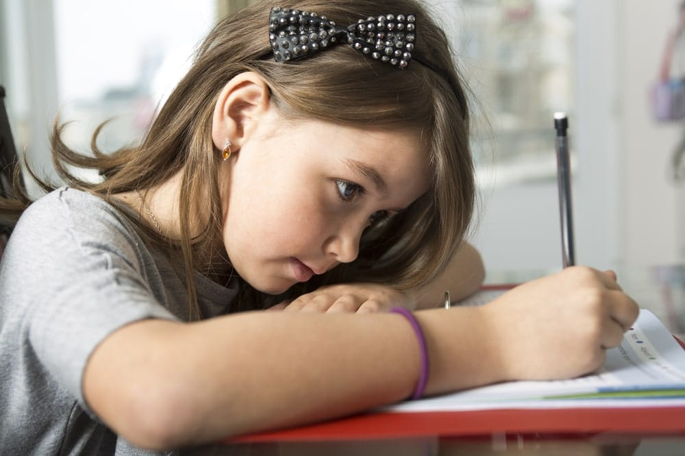 Young-Girl-Writing