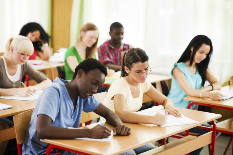 students-writing-notebooks